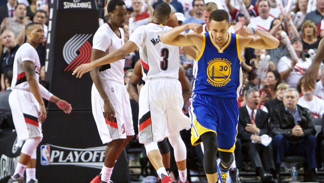 Golden State Warriors guard Stephen Curry (30) reacts after scoring a basket against the Portland Trail Blazers during the second half of Game 4 of an NBA basketball second-round playoff series Monday, May 9, 2016, in Portland, Ore. The Warriors won 132-125. (AP Photo/Craig Mitchelldyer)