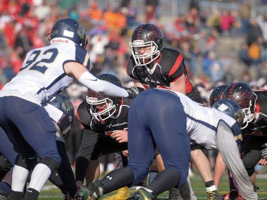 Newark Valley senior quarterback Collen Hills gets