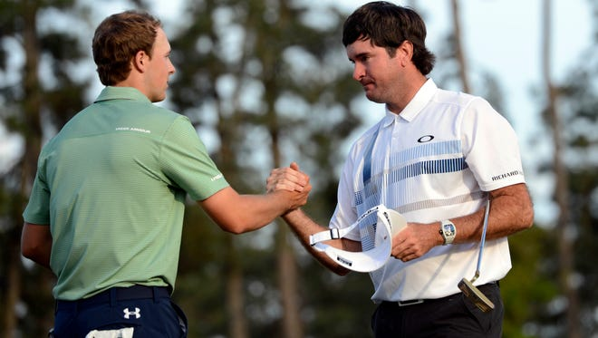 Jordan Spieth (left) congratulates Bubba Watson (right) after Watson won the 2014 Masters golf tournament at Augusta National Golf Club on Sunday. Watson, who previously won in 2012, shot a final-round 69, while the 20-year-old Spieth carded an even-par 72.