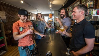 (L-R) Brandon Galluppi of Dover, Co-owner of 2nd Act Beer, 2nd Act Beer co-owner Stu Blake of Dover, Craig Cirinelli of Boonton and lead singer of the band Hidden Cabins, and Frankie McDonald of Bootnon, owner of Boonton Coffee, sample the new beer at Boonton Coffee in Boonton, October 19, 2017.  Photo by Warren Westura for the Daily Record.