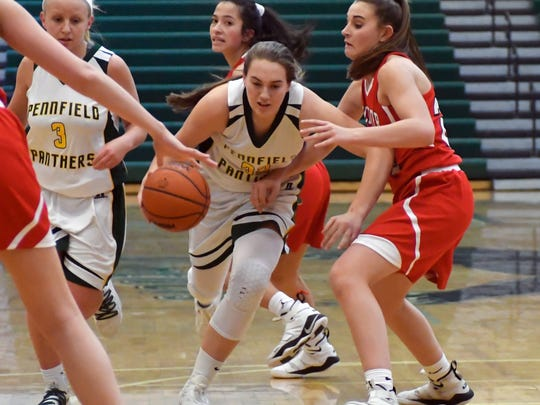 Pennfield's Alicia Lake (32) drives between several Coldwater defenders during game action Tuesday night.