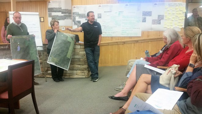 While Village Manager Debi Lee and Deputy Manager Ron Sena held maps showing different proposed layouts for recreational facilities, Village Parks and Recreation Director Rodney Griego went over details.