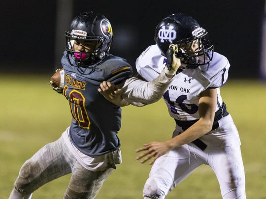 Tulare Union's Kazmeir Allen, left, fends off Mission Oak's Alan Smith on Friday in an East Yosemite League game at Bob Mathias Stadium.