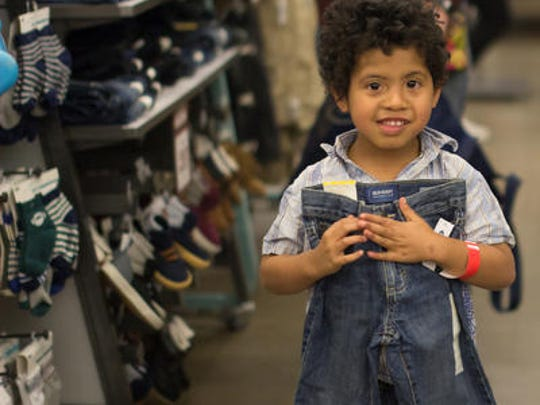 Deyshawn Smith of Las Cruces finds the perfect pair of jeans during a recent Dress the Child shopping event at Old Navy.