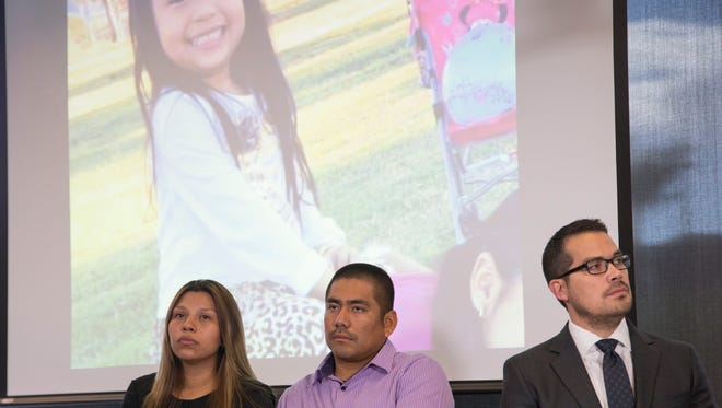 Vanessa's parents (left) and their attorney James Goodnow attend a Phoenix press conference on Tuesday, Aug. 23, 2016. Vanessa was hit by a Phoenix police cruiser after getting ice cream from a truck near 72nd Avenue and Camelback Road.