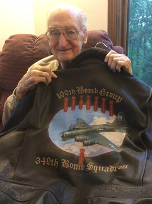 Green Bay resident Jim Sorenson holds a custom-made leather jacket recently given to him by his grandson Shawn Lynch that honors Sorenson's service during World War II with the 349th Bomb Squadron of the United States Army Air Forces. Sorenson turned 91 on Saturday.