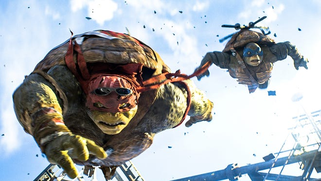 Raphael, left, and Leonardo helped 'Ninja Turtles' soar to the number one spot at the box office on the film's opening weekend