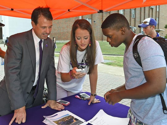 Northwestern State University Vice President for The Student Experience Chris Maggio (left) and NSU student Faith Stanfield of Natchitoches (center) help student Orlondan Williams of Monroe find his first class Monday as the university began fall classes.