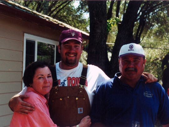 Tom Gore hugs his Aunt Cynthia and his father, Tom Gore Sr.