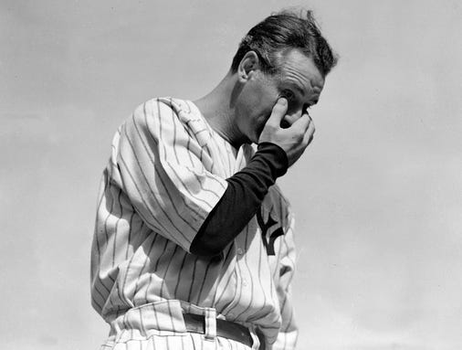 """In this July 4, 1939, file photo, New York Yankees' Lou Gehrig wipes away a tear while speaking during a tribute at Yankee Stadium in New York. The league will conduct special on-field ceremonies to commemorate the 75th anniversary of Gehrig's """"Luckiest Man"""" speech and honor his legacy on July 4, 2014. Gehrig passed away on June 2, 1941 at the age of 37."""