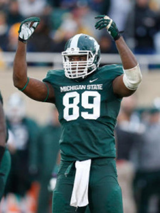 Michigan State's Shilique Calhoun was the 2013 Big Ten Defensive Lineman of the Year after a breakout season for the Rose Bowl champions. (Getty Images)