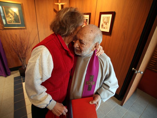 Therese McGratty of Grosse Pointe Farms, left, says goodbye to Rev. Peter Lentine of St. Philomena church in Detroit on Wednesday, March 30, 2011.