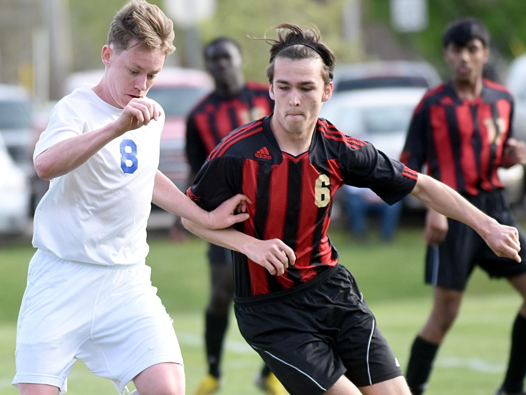 White House High junior Austin Blansett maintains possession amidst pressure from Rossview senior Jared Stanford during first-half action.