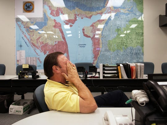 Then: Oct. 6, 2004, Charlotte County Emergency Operations Director Wayne Sallade rubs his eyes as he recalls his experiences during the last two months of the recovery effort from recent hurricanes in Charlotte County on Wednesday, Oct. 6.
