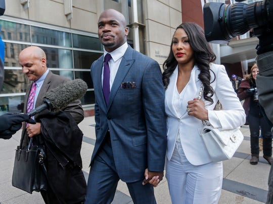 Minnesota Vikings running back Adrian Peterson leaves the U.S. District Courthouse with his wife Ashley Brown Peterson on Feb. 6, 2015, in Minneapolis.