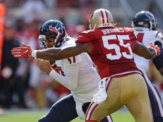 Houston Texans quarterback Brock Osweiler, left, is stopped and brought down by San Francisco 49ers outside linebacker Ahmad Brooks during the first half of an NFL preseason football game Sunday, Aug. 14, 2016, in Santa Clara, Calif. (AP Photo/Ben Margot)