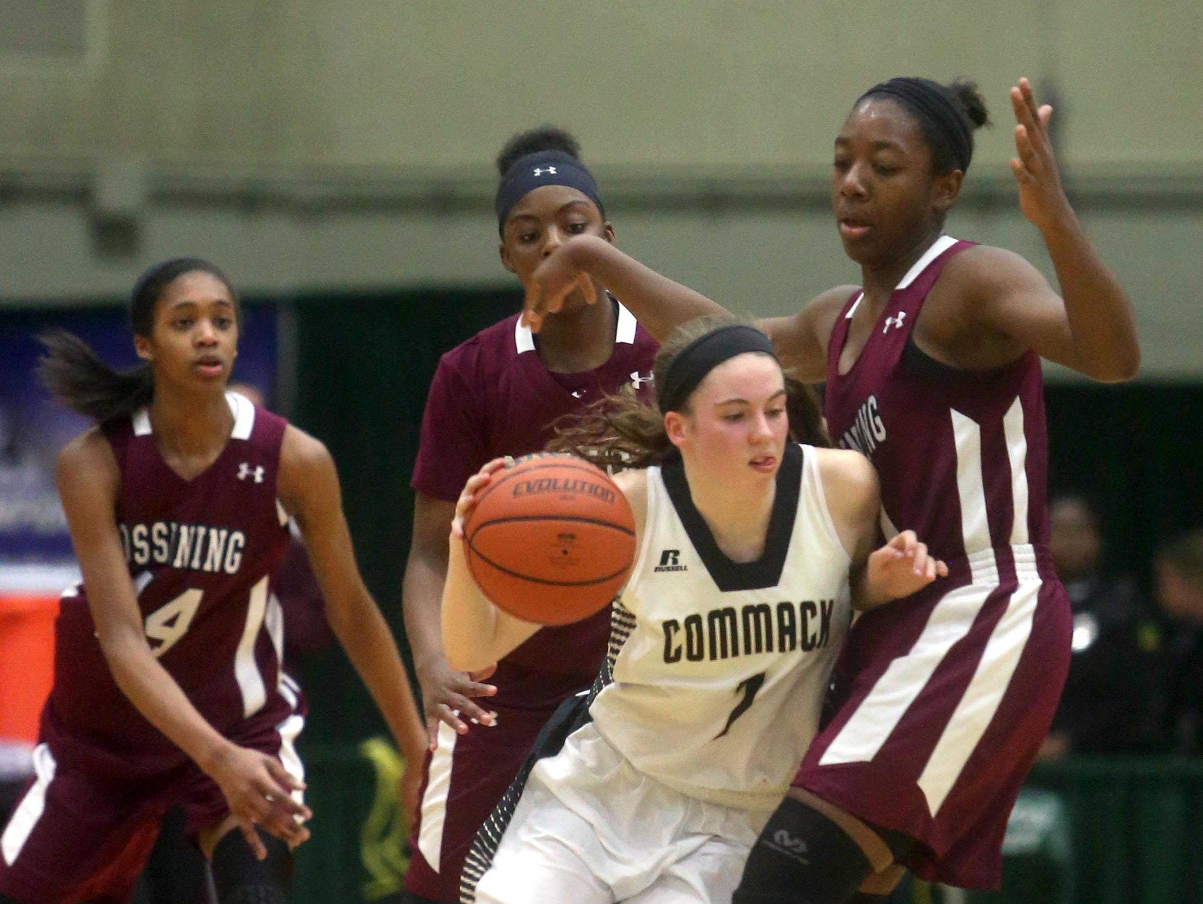 Commack's Casey Hearns runs into Ossining's Shadeen Samuels during a New York State Class AA semifinal game at Hudson Valley Community College in Troy March 11, 2016. Samuels led all scorers with 32 points as Ossining defeated Cormack 72-55.