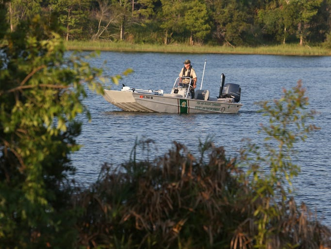 Authorities search for 2 year old dragged into water by for Florida fish wildlife