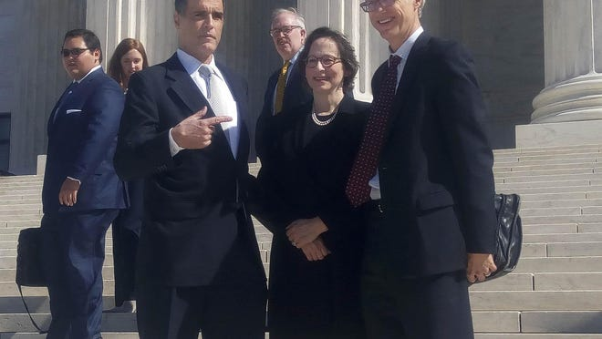 Fane Lozman, left, with his attorneys, Stanford University law Professors Pamela Karlan and Jeffrey Fisher, outside the U.S. Supreme Court in 2018.