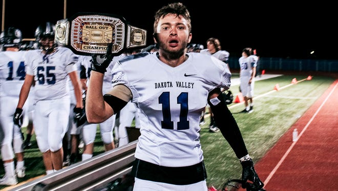 "Dakota Valley's Luke Johnson poses with the prized ""Ball Out Champion Belt"""