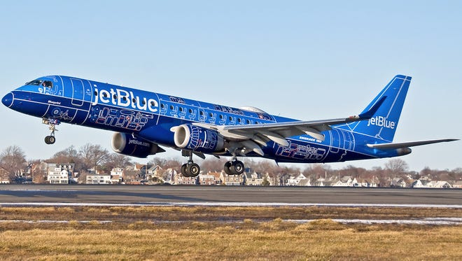 "JetBlue provided this undated photo of an Embraer E190 painted in the carrier's new ""Blueprint"" special livery."
