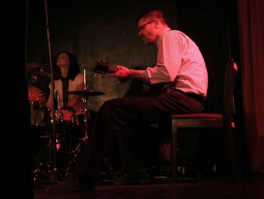 Joanna Durfee and her father, Ryan Durfee, perform