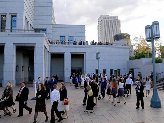 Members of The Church of Jesus Christ of Latter-day Saints gather outside the church's Conference Center in Salt Lake City  on Saturday as they attend the Semiannual General Conference.