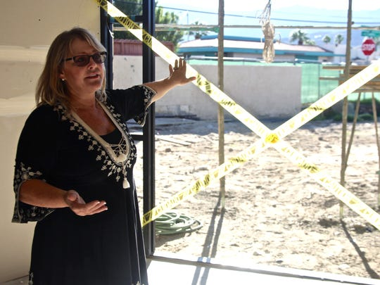 Lorie Loftis, CEO of Venus de Fido, talks about the facility during a tour around its construction site in Palm Desert on Sunday, Nov. 22, 2015. Currently under construction, the health and wellness center for pets and humans is expected to open its doors in February.