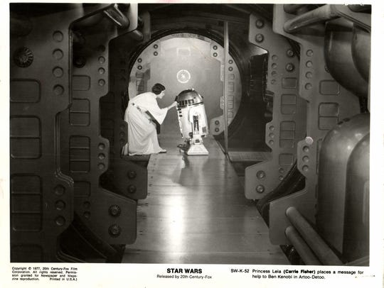 Princess Leia (Carrie Fisher) places a message for
