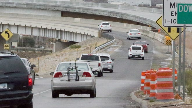 Drivers make their way from Sunland Park Drive onto the flyover ramp to Interstate 10 East in March. A new ramp is visible just above the old one.