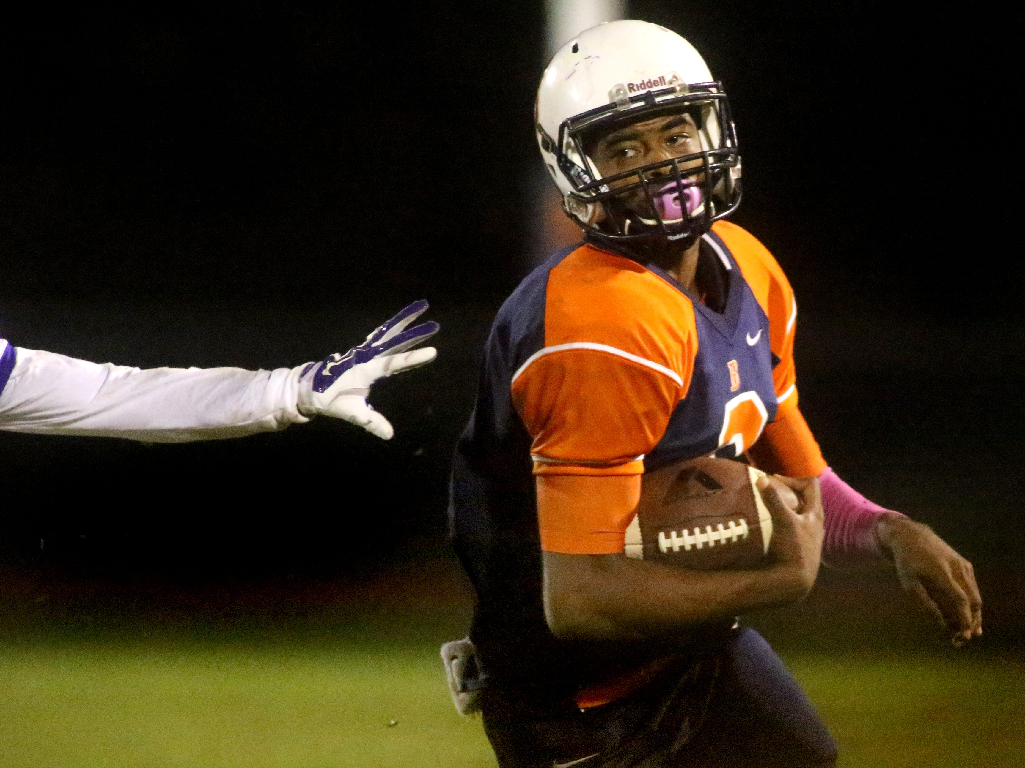 Blackman's quarterback Jauan Jennings runs down the sidelines as he gets pushed out of bounds during the game against Smyrna at Blackman, on Friday, October 17, 2014.