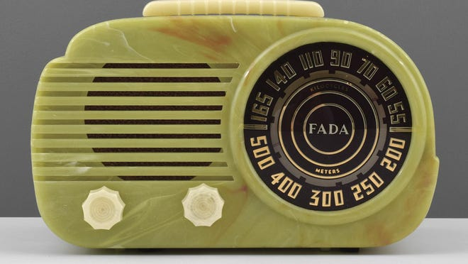 This plastic Fada radio was made about 1941. It is alabaster in color and about 6-by-10-by-6 inches. Now faded to a light green, it sold for $1,000.