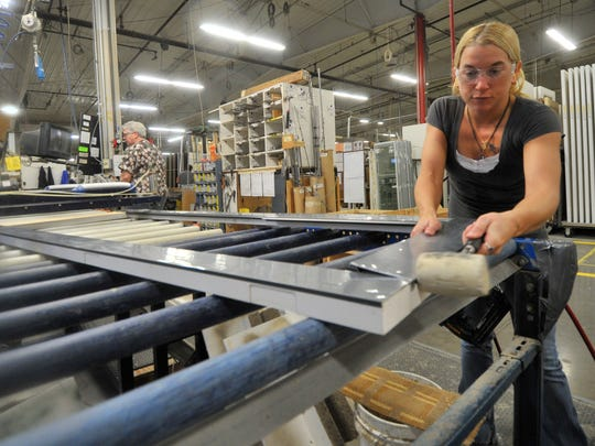Worker Rose Spiegel, of Merrill, works on a door frame at Kolbe & Kolbe Millwork Company in Wausau.