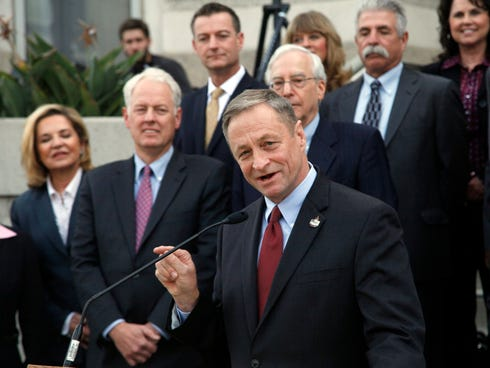 Sam Smith, president of the California Association of Health Underwriters, speaks at a news conference in Los Angeles  Dec  2,  2013. California has opened an online insurance exchange for small businesses, with questions looming about how many emplo