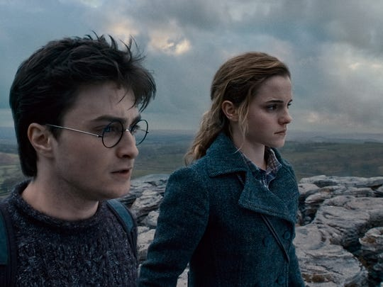 """Daniel Radcliffe as Harry Potter and Emma Watson as Hermione Granger in Warner Bros. Pictures' fantasy adventure """"Harry Potter and the Deathly Hallows: Part 1."""""""