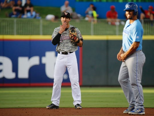 Chase D'Arnaud, El Paso Chihuahuas shortstop keeps an eye on a runner at second base during a recent game against the Omaha Storm Chasers.