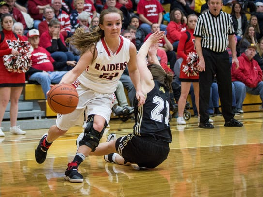 Wapahani's Haley Strombeck drives into Lapel's defense