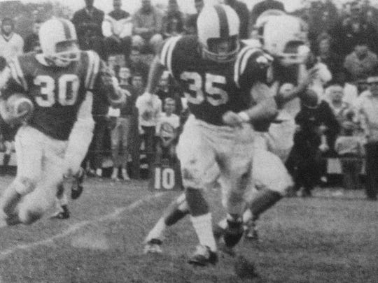 Brick running back Bill Hess carries the ball for Brick's undefeated team in 1966