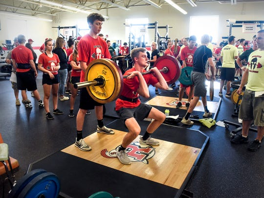 Area athletes try for a clean lift for the judges during the Spartan Challenge Tuesday, July 31, at the Rocori High School in Cold Spring. Area athletes competed in weight lifting, a 40-yard dash, vertical jump and agility events.