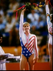 Kathy Johnson waves to the crowd during the 1984 Summer