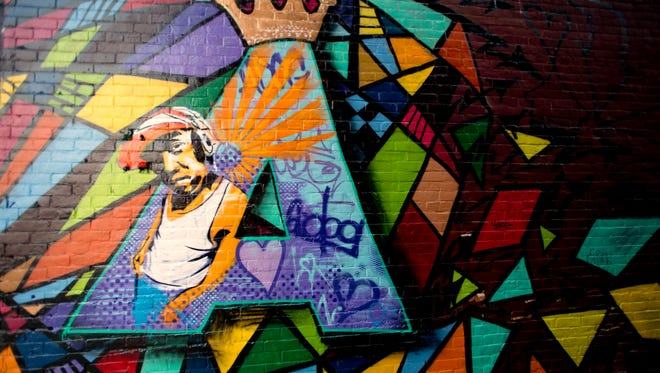 An ode to DJ A-Dog created by artists Brian Clark, Scottie Raymond, Jeff Philie and John Young in the alley around the corner from Nectar's on Main Street in Burlington. Williams died in December after battling leukemia.