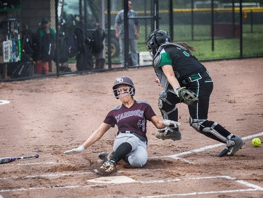 Maddie Richards slides into home during Wes-Del's 6-4