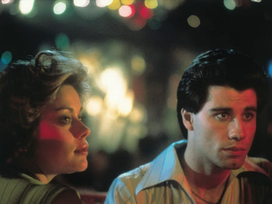 still-of-john-travolta-and-donna-pescow-in-saturday-night-fever-(1977)-large.jpg