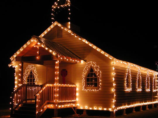 The Whiteville Church in Le Vieux Village is shown decked out in its holiday lights. The annual Lighting of the Village is 5-8:30 p.m. Dec. 4.