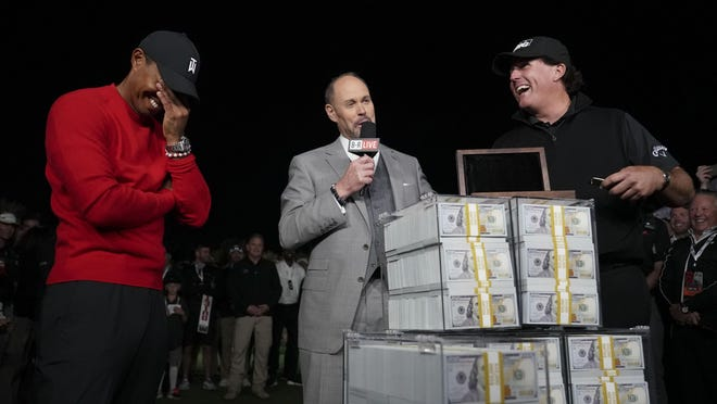 Phil Mickelson (right) reacts after the winner's belt didn't fit as Tiger Woods  looks on after their first dual match in Las Vegas in November 2018.
