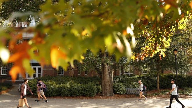 Students walk by the Tate Student Center on the campus of the University of Georgia last month.