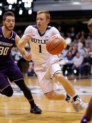Butler guard Tyler Lewis (1) drives around Northwestern's Bryant McIntosh (30) during the Bulldogs' win Wednesday night.