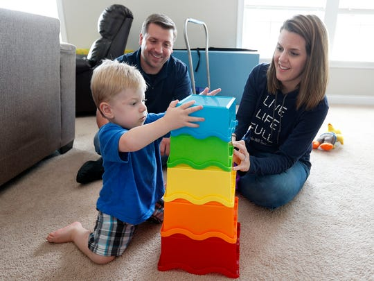 Blake and Natalie Brenneman play with their 20-month-old