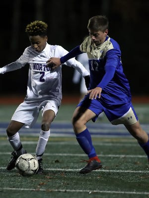 Norwell's Mischa Spasic and Norton's Nolan Winfield vie for the ball during second half action of the Division 3 South semifinal at Medway High on Wednesday, Nov. 13, 2019.