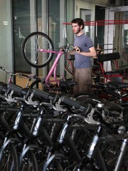 You can rent bikes at Cincinnati Bike Center, 120 E. Mehring Way, in Smale Park.